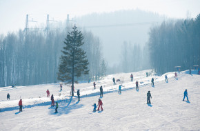 People ski at Sable Mountain in Baykalsk, Russia